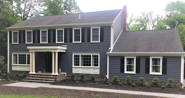 new blue siding and trim on large home