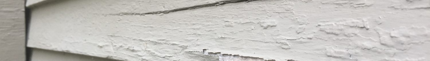 wood siding chipping on house